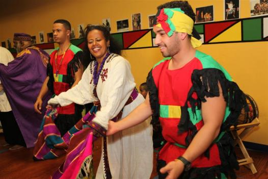 Ethiopian dancer Almaz Getahun performs with members of the African Heritage Dancers and Drummers