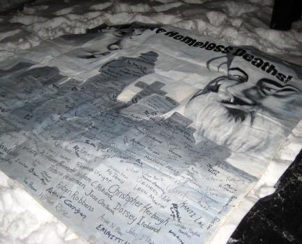 At the 20th Annual National Homeless Persons' Memorial, one banner features a handwritten list of names of people who died while homeless, in and around D.C., in 2009.