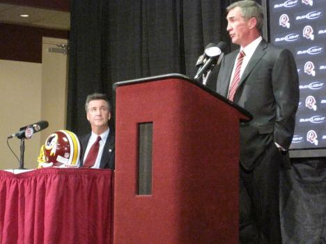 Mike Shanahan, new head coach of the Washington Redskins. New General Manager Bruce Allen sits next to him.