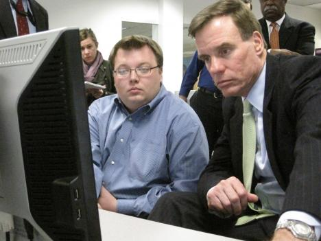 Sen. Mark Warner (D-Va.) learns about Geospatial Technology (GST) with NOVA GST student Chris Wideman.