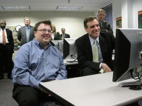 Northern Virginia Community College student Chris Wideman shows Senator Warner Geospatial Technology software.