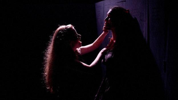 Lucy (Megan Graves) pushes back against a bully (Natalie Cutcher) in The Washington Rogues' production of In The Forest, She Grew Fangs.