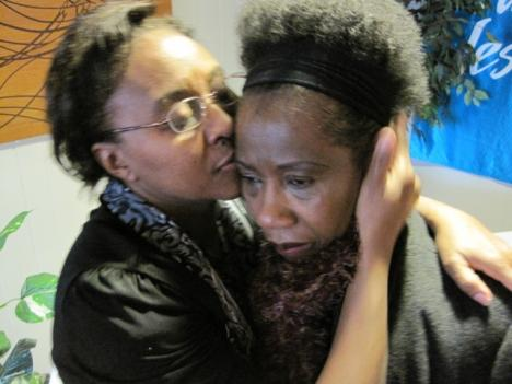 A Haitian church member is comforted by a fellow parish member. She lost her niece and cousin during the earthquake in Haiti. She says their bodies were too decomposed for surviving family members to recover.