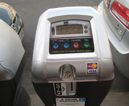 New solar powered parking meters accept credit cards for payment.