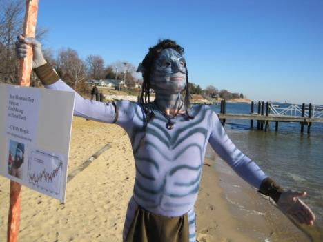"""An attendee dressed as a """"Navi"""" from the new movie """"Avatar."""" Some believe the film has an environmental advocacy message."""