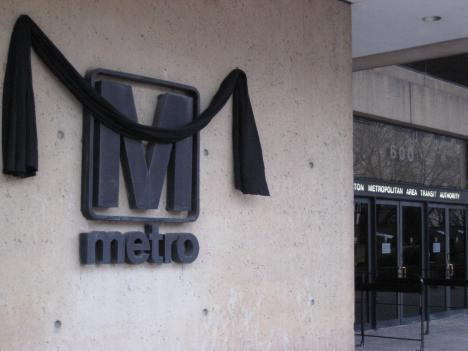 A black banner outside Metro's headquarters commemorates the two employees killed on the tracks early Tuesday morning.