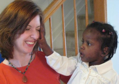 Christie Hubner and Ila, her 3-year-old newly-adopted daughter from Haiti.