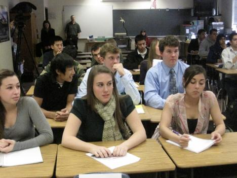 Falls Church H.S. AP Government students listen as federal, state and local education officials give a lesson on education funding.