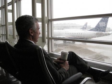 One passenger prepares for a long wait at Reagan National Airport as the snow begins to fall.