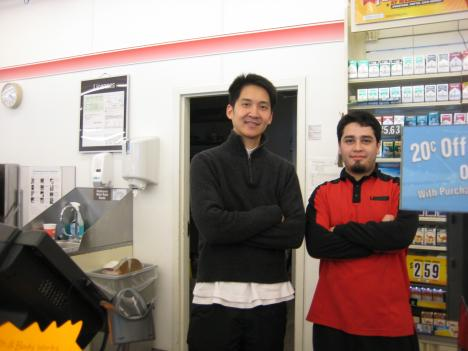 Kevin Chittiwauttinon and Justin Scherzad work at the Locust Point 7-11 in South Baltimore, where a city-wide driving ban kept customers away.