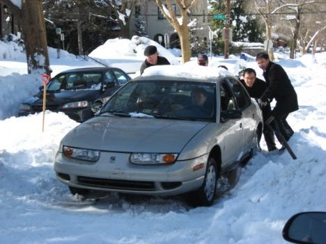 Neighbors on Veazey Street in northwest Washington, D.C. rescue a stranded office worker whose car got stuck.