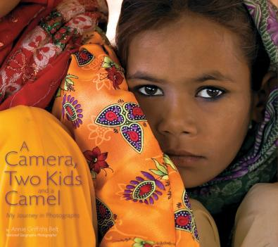"Cover photo of ""A Camera, Two Kids and a Camel"" exhibit manual featuring the work of Annie Griffiths Belt, one of National Geographic's first female photographers, on exhibit through September 14, 2008."