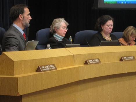 Fairfax's school board voted to cut close to 600 jobs, while saving some popular programs like freshman sports, and elementary foreign language classes.