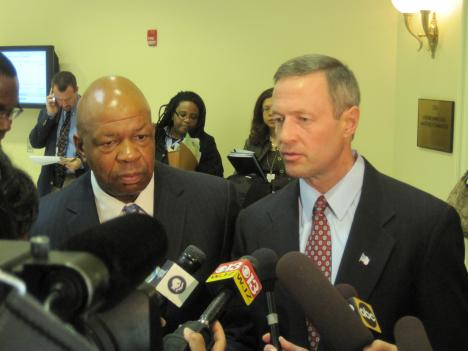 Baltimore Congressman Elijah Cummings (left) and Maryland Governor Martin O'Malley speak with reports after a state house committee meeting in Annapolis.