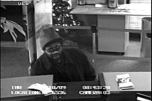 Detectives are searching for this suspect in connection to a bank robbery.
