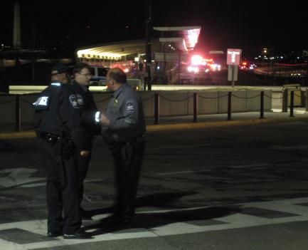 Police cordoned off the area around the Pentagon Metro entrance after a gunman opened fire Thursday evening, wounding two Pentagon Police officers.