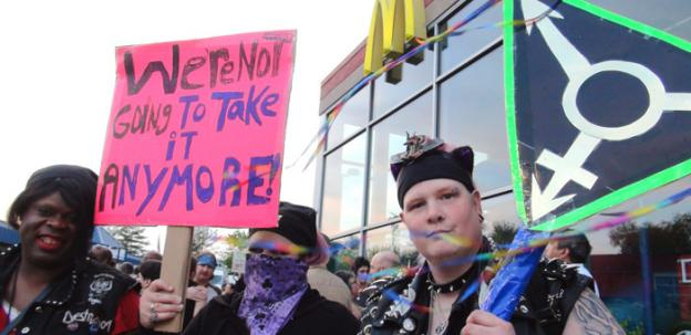 Protesters gathered at a rally outside the McDonald's in Rosedale, Md., in April to call for more protections for transgender people. Baltimore County just passed a law prohibiting transgender discrimination.