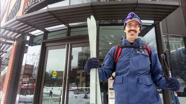 Matt McCleskey poses with his skis outside the WAMU Media Center on Connecticut Ave NW.