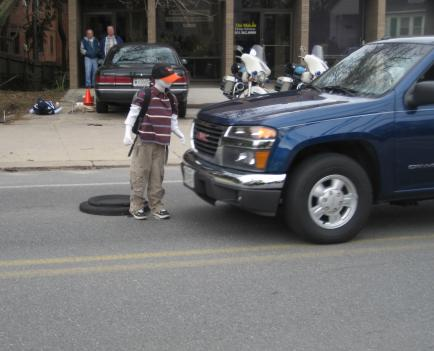 """Bobby"" is a dummy that is supposed to be a 10-year-old boy.  He's crossing Sligo Avenue in Silver Spring."