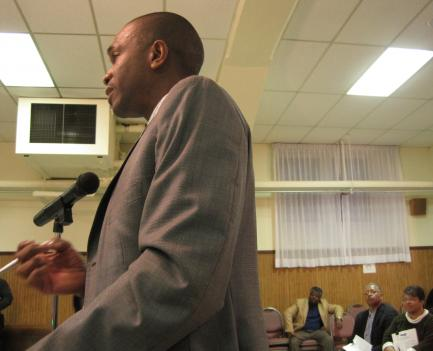 Fort Washington, Md. resident Anthony Mitchell pleads with Metro manager not to cut his bus service at a public hearing in Southeast D.C.