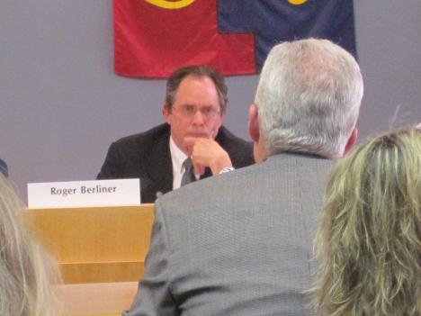 Montgomery County councilman Roger Berliner listens to an answer from county inspector general Tom Dagley during a hearing on the county's tuition assitance program for employees.