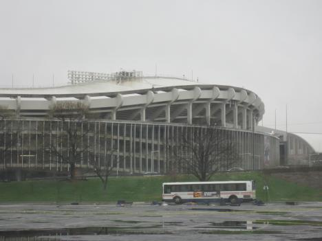 """The ill-fated bus awaits, as RFK Stadium towers above. A special crew will """"stage"""" a small explosion inside to simulate a real emergency."""