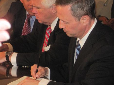 Gov. Martin O'Malley signed a bill requiring the French national railroad to publish its Holocaust-era records if its U.S. subsidiary is to receive a state contract.