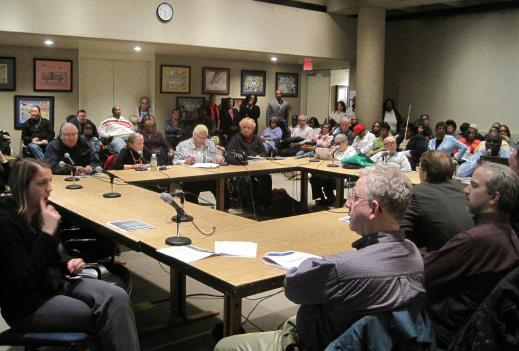 Residents listen to Metro officials brief them on proposed changes to the Metro Access service.