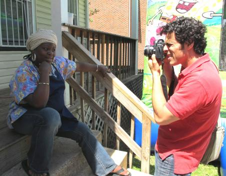 Photographer Danny Harris snaps a picture of Ajae on her cousin's front porch in Anacostia. Harris is compiling a people's history of the District.