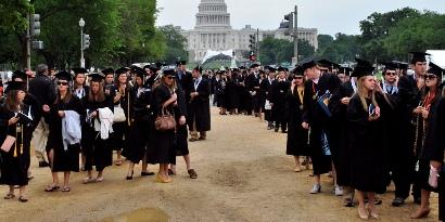 George Washington University Students line up on the mall, waiting to be seated for commencement.