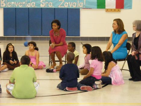 First Ladies Michelle Obama (left) and Margarita Zavala (right, in blue) of Mexico exercise with/take questions from students at New Hampshire Estates Elementary School in Silver Spring, MD.