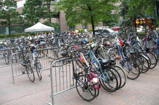 photos Peter Granitz  to: kjohnson 05/23/2010 04:43 PM Show Details        Valet workers parked hundreds of bikes in Crystal City as riders took in displays from bike advocacy groups in the Metro region.