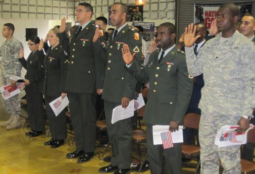 Members of the U.S. military take their oath of citizenship during a ceremony in Silver Spring, Maryland.