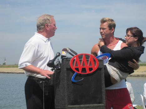 "Ocean City Mayor Rick Meehan (left) with Rodney (right), the official ""spokesguard"" for Ocean City. Rodney is ""rescuing"" a woman from boredom at her job and taking her to Ocean City for some fun."