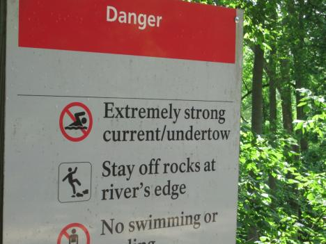 A sign on the river's edge near the Angler's boat area warns of the dangers in the Potomac.