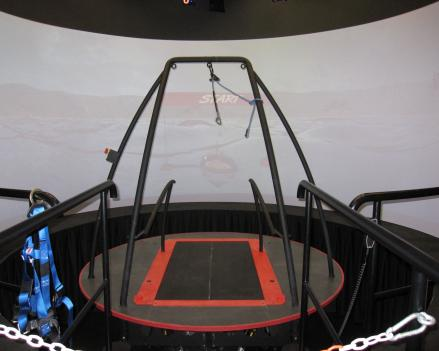The Computer Assisted Rehabilitation Environment (CAREN) is a simulator made of a platform with a treadmill that stands in front of a 180-degree screen with 12 motion cameras focusing on the platform where the patient stands.