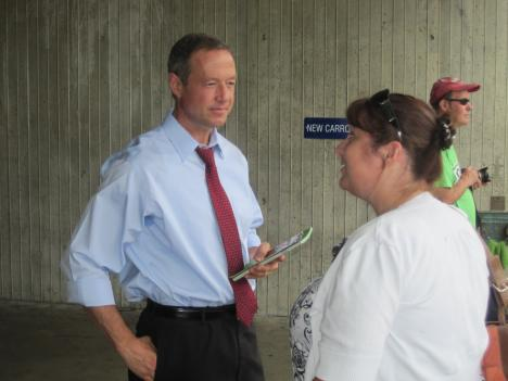 Maryland governor Martin O'Malley speaks with riders at the New Carrollton metro station, which is one of the end points for the proposed Purple Line.