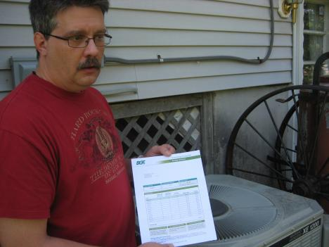 Owings Mills resident Mike Fold reads a statement from BGE which shows his electricity rebate for cutting consumption on peak days. Rebates are part of BGE's new Smart Grid program.