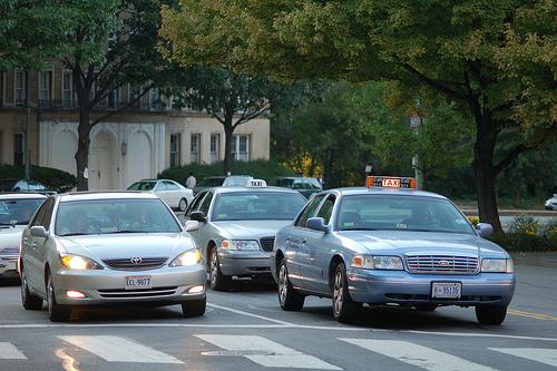 Drivers are fighting the city of Alexandria's regulation that requires each taxi driver to take two dispatch calls per day.