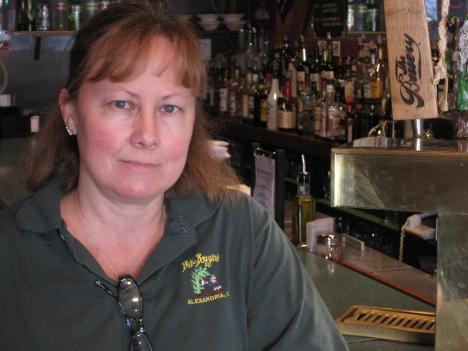Linda Armellino, owner of Bilbo Baggins Cafe and The Green Dragon Pub in Alexandria, says she's still not sure what privatizing state liquor stores would mean for her business.