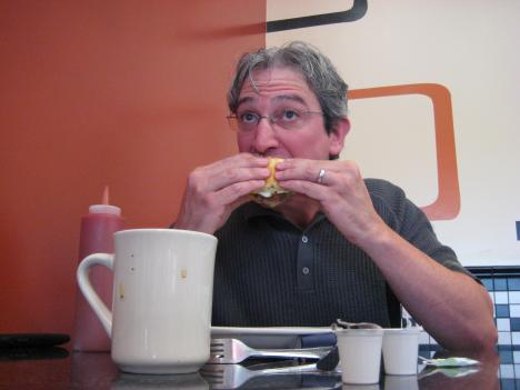 Breakfast In Washington writer/producer Simon Epstein digs in to MGM Roast Beef's signature breakfast sandwich, The Bellybuster.