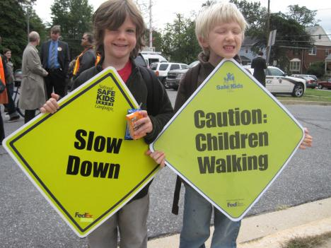 East Silver Spring Elementary students Caleb Savoie and Oliver Nan get ready for Walk-to-School Day.