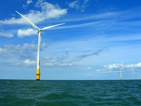 An offshore wind turbine stands in the Thames Estuary. Google says it will invest in transmission lines from East Coast states to offshore wind farms, which have not yet been built.