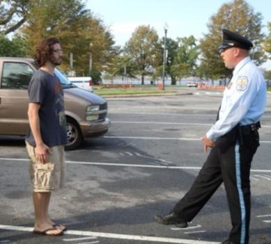 Police work with volunteers to demonstrate how alcohol consumption impairs motor skills.