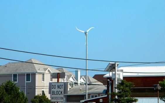 The 40-foot wind turbine outside Nantuckets Restaurant in Fenwick Island, Del., is one of 100 wind and solar projects in the area.