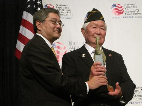 Grant Ichikawa, a Japanese American veteran of WWII, accepts a Patriotism Award from NJAMF Chairman Craig Uchida, on behalf of the Military Intelligence Service.