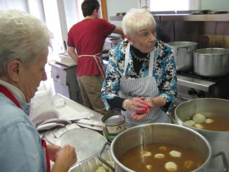 The elders of Christ Church United Locust Point including Dolores Uzarowski [center] add dumplings to the sour beef gravy.  They'll serve hundreds of meals over a weekend.