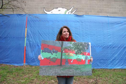 Business owner Kim Houghton covered the mural with a tarp in August.