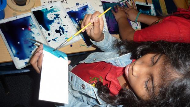 Third graders at the Community Academy Public Charter School apply what they've learned about the Washington Color School to make their own abstract art.