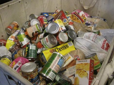 The executive director of the Arlington Food Assistance Center says his staff sees fewer expired cans among their donations, perhaps a small sign the economy is turning around.